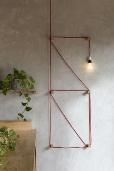 Detail of a wall-hung light at Jury, a restaurant in a converted prison in Melbourne, by BIasol Design Studio