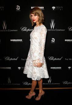 Taylor Swift.. Oscar de la Renta dress, Jimmy Choo 'Kendo' shoes, Christian Louboutin clutch, and Lorraine Schwartz jewels..