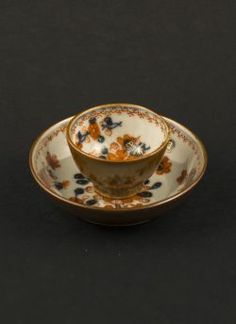 Qianlong - Chinese Imari miniature cup and saucer with flower decor and the reverse of both painted in Batavia brown (Capuchin)