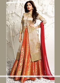 Be an angel and create and establish a smashing influence on everyone by wearing this Shilpa Shetty beige and orange jacquard, raw silk and viscose long choli lehenga. The lovely embroidered, resham a. Indian Gowns Dresses, Indian Fashion Dresses, Indian Designer Outfits, Pakistani Dresses, Indian Outfits, Designer Party Wear Dresses, Kurti Designs Party Wear, Lehenga Designs, Long Choli Lehenga