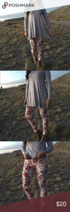 << Red Floral Leggings >> So cute and so bright! A beautiful blend of colors that stand out in a crowd! Fit true to size, I'm a large size 8/10 and am wearing the large. 95% cotton 5% Spandex Pants Leggings