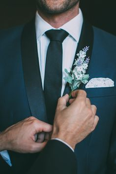 Navy groom suit with lavender boutonniere | Fiona + Bobby Photography | See more: http://theweddingplaybook.com/modern-industrial-cocktail-wedding/