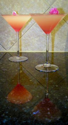 Ruby Rose Martini  1 oz. Elderflower Syrup  1/2 oz. Lemon Juice 3 oz. Pear Vodka 1 oz. Ruby Red Grapefruit Juice  Directions: Pour over ice, shake, pour into glass, garnish, and enjoy!