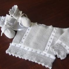 This place specializes in hand made baby to eight years. They are beautiful! Cute Baby Clothes, Girl Doll Clothes, Knit Baby Sweaters, Baby Socks, Girl With Hat, Crochet For Kids, Baby Wearing, Baby Knitting, Baby Dress