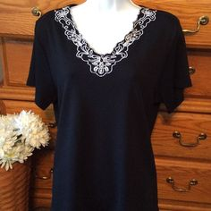 """JM Collection Black Tunic 100% cotton and in very good condition.  Maybe wore a few times.  White embroidery around the v neck only.  Short sleeve.  Approximately 25"""" in length.  Measured flat straight across armpit to armpit is 20"""".  Does have nice stretch.  Petite XL JM Collection Tops Tunics"""