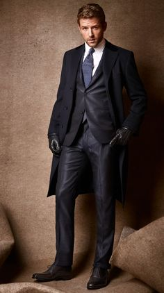 Cashmere coat by Salvatore Ferragamo. Two-button wool-silk-and-polyamide suit and lambskin gloves by Hermès. Cotton shirt by Brunello Cucinelli. Silk tie by Paul Stuart. Leather shoes by J. M. Weston.