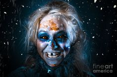 Evil winter monster smiling in chilling style beneath falling snow. Zombie elf by Ryan Jorgensen