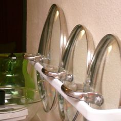 Pot Lid Organizer -salvaged towel racks - or would old curtain rods work? - attached inside cabinet doors.