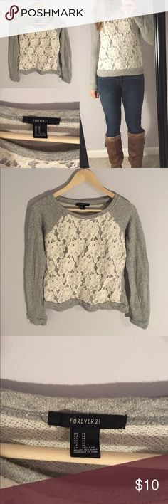 F21 Grey Lace Front Sweater This cute grey sweater from Forever21 has cream lace details across the front. It is plain grey in the back. Size medium but fits more like a small or x-small. Feel free to ask any questions! Forever 21 Sweaters Crew & Scoop Necks