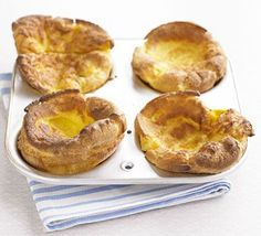 The secret to getting gloriously puffed-up  Yorkshires is to have the fat sizzling hot  – and don't open the oven door!
