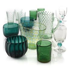 A set of eight George IV green glass finger bowls circa 1820 Together with a multi-colored glass vase, modern; thirteen water goblets with a green ball stem; and thirteen green iced tea glasses and a pitcher, Christian Dior.  47 pieces. height of the finger bowls 3 3/4 in.