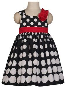 Love this pretty sundress. Red pleated empire waist and a red rosette detail on the left shoulder with white polka dot print.