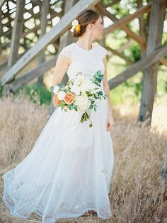 Light wedding gown with cap sleeves.
