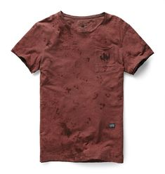Round neck tee with a single patch pocket and raw-edge sleeves. The shoulder seam is visibly reinforced with an external binding.