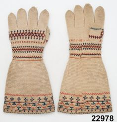 Vantar (mittens); estimated years of use, 1725-1775, year of accession 1879, Nordiska Museum; A pair of women's gloves with long cuffs . The hand is plain knit in white wool yarn with pattern borders in red and blue, the cuffs are nalbound in the  same white yarn with embroidered decoration in red and blue wool yarn.  The yarn is of 1700s glossy long-fiber wool. Have been used as bridal gloves and reportedly passed down for 7 generations. Possibly a type of Finnish origin.