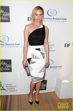 Amber Valletta in Roland Mouret dress, Christian Louboutin shoes, and an Edie Parker bag.