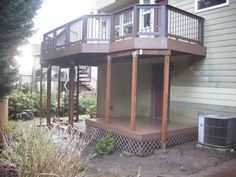 Deck in Lake Oswego as a replacement for an old set of cedar decks. The old decks were slippery when wet and a real hazard to walk on. We used Timbertech Earthwood Evolutions Pacific walnut decking, the Timbertech Builder rail for the railing, and installed an Fontanot Eureka metal spiral staircase to get down to the back yard. It was a much needed improvement and raised the property value of the house too!