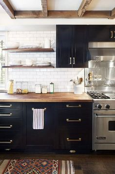 White Kitchen With Brass, Navy and Wood Accents