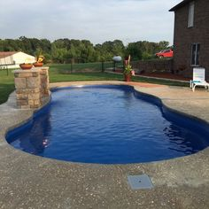 "Congratulations to the team at Mr. Pools in Sedalia, MO on their recent Leisure Pools ""Riviera"" fiberglass swimming pool installation. Wrap around bench seat for a generous entrance along with a deep end seat. Shallow end at 3 feet 11 inches with a deep end at 5' 10"" with 35 feet of length to enjoy. Are you ready for your life of leisure? If so, call (660) 596-3293 for Mr. Pools in the Sedalia area or dial (855) 55-SPLASH everywhere else to find your nearest Leisure Pools dealer."