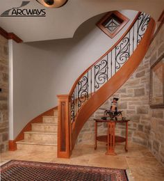 Mediterranean curved staircase...love the railing and the rock underneath