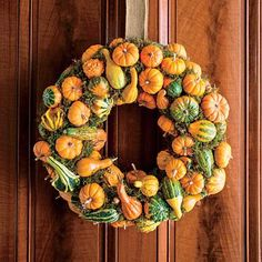 Pumpkin and Gourd Wreath | Deck out your front door with this impressive wreath of pumpkins and gourds. | SouthernLiving.com