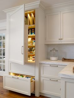 pantry cabinets---Love that there are interior lights here.