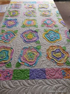 Ardella's bright French Roses quilt – playful freehand feathers and flowers in the borders. Simple bg fill and in roses to pop. Hobbs batt and Superior Omni thread in white. Quilt Baby, Baby Patchwork Quilt, Lap Quilts, Crochet Quilt, Scrappy Quilts, Mini Quilts, Aplique Quilts, Homemade Quilts, Fabric Postcards