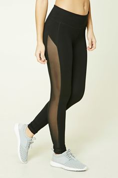 A pair of stretch-knit athletic leggings featuring side sheer mesh panels, a hidden key pocket, and an elasticized waist.