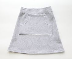 Turn pair of sweatpants into a cute, comfy sweatpant skirt with this step by step sewing tutorial. Great way to upcycle thrifted sweats.
