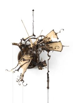 Eric Freitas, clock.  These clocks are amazing.  He handcrafts each and every cog and mechanism inside these clocks.  Each is one of a kind.