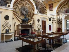 The Armoury Hall is lined with broadswords, muskets and pole arms-Inverary Castle