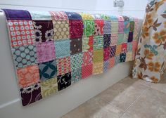 Patchwork bathmat - quilt squares on an old towel - brilliant!