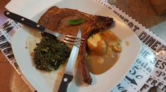 T-bone steak accompanied by abit of spinach and mash and gravy on the side