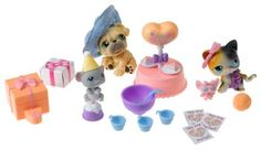 """Littlest Pet Shop Birthday Celebration Playset by Hasbro. $60.05. Three adorable pets come with 20 party-time accessories, including a big gift that each pet can """"open"""" with its paw!. Playset includes dog, cat and mouse figures, 3 invitations, punch bowl, ladle, 3 cups, 2 pieces of cake, cake, and so much more!!. This is one party that never has to end!. Serve punch, cake and be sure to play plenty of games!. Amazon.com Break out the balloons, it..."""