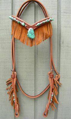 turquoise & leather fringe headstall #horse #tack I think, for my horse, I'd like a very dark leather. But this is very cool.
