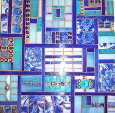 And another nice mosaic by Natalie  Warne! Uses china from a vase, stained glass, and beads. Very pretty!