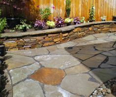 Google Image Result for http://crystalscapes.com/wp-content/uploads/2010/10/Flagstone_patio_rock_wall.jpg