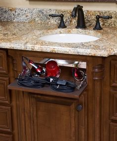 Vanity secret valet for curling  flat irons and hair dryers. This is a MUST for all the hair tools in our house.