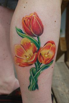 Tulip tattoo idea in purple, the leaves are a little too much for me, take the bottom and make into a heart w/ wings?