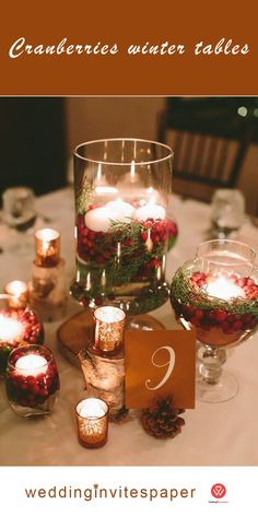 a cozy traditional Christmas wedding centerpiece of pinecones, mercury glass candle holders and jars with evergreens, cranberries and candles wedding centerpieces Christmas Wedding Centerpieces, Red Centerpieces, Winter Wedding Decorations, Wedding Table Centerpieces, Centerpiece Ideas, Cranberry Centerpiece, Christmas Wedding Flowers, Decor Wedding, Wedding Reception