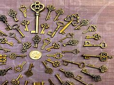 Great variety set of vintage / antique skeleton look key charms!  Various sizes from 1 to 2 & 1/2 tall! Made of metal. Mostly double sided, with a few flat backed keys.  Keep in mind these are reproductions, not actual working keys!  Perfect for crafts, scrap-booking, jewelry, wedding tags or place settings, collections, display - the uses are limited on by your imagination. Custom sets available upon request.  I may sometimes have to substitute similar size, shape or color keys...