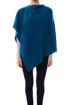 Add this feather-light flowy poncho to your wardrobe for an easy layer of warmth. Toss it over any outfit for the optimal addition to your boho chic look.   Cashmere Poncho by 7 on Locust. Clothing - Tops - Long Sleeve Clothing - Tops - Blouses & Shirts California