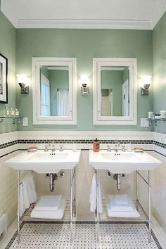 Medicine cabinet for each sink with 3 sconces.  Like the sconce style too.