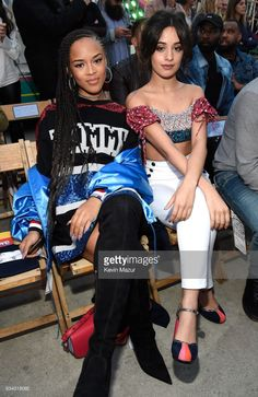 Singer/actress Serayah McNeill (L) and singer Camila Cabello at the TommyLand Tommy Hilfiger Spring 2017 Fashion Show on February 8, 2017 in Venice, California.