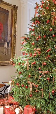 Add fillers to make the tree look fuller; you can use green tinsel, artificial spruce garlands or green tulle or netting, woven into the branches