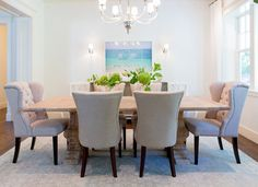 Elegant dining room features a Vivian One Tier Chandelier illuminating a reclaimed wood trestle dining table by Restoration Hardware lined with beige tufted dining chairs atop an ivory and pink rug. Tufted Dining Chairs, Trestle Dining Tables, Dining Room Furniture, Dining Room Table, Dining Sets, Pink Dining Rooms, Elegant Dining Room, White Wash Table, Dovetail Furniture