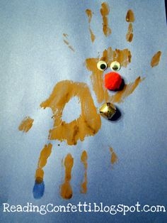 Great Christmas craft idea - Hand print reindeer!  Two hand prints and a pompom, jingle bell and a couple of googly eyes! easy