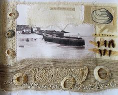 """CAROLYN SAXBY MIXED MEDIA TEXTILE ART: """"The Sky was Cloudless and Bright""""; her own photograph of St. Ives harbour stitched to calico with linen, cotton, vintage knitted piece, limpet shells, lace, rafia, cloves, hand stitching and some machine stitching Read more: http://carolynsaxby.blogspot.com/2012/03/work-from-our-exhibition-inspired-to.html#ixzz4mvBRgvwt Under Creative Commons License: Attribution."""