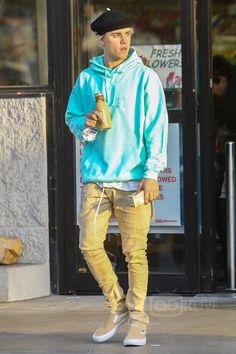 Justin Bieber wearing  LMDN Distressed Tiffany Hoodie, Fear of God The Drawstring Trousers, Silver Spoon Attire Wool Beret With Pin, Vans Slip On Pro Skate Shoes