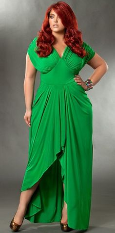 I love the cut of the dress. It accentuates her waist. (I want this dress its so beautiful & me!!!
